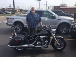 2-20-2017 Sam with new bike at TN dealer. My new F150 in background..jpg